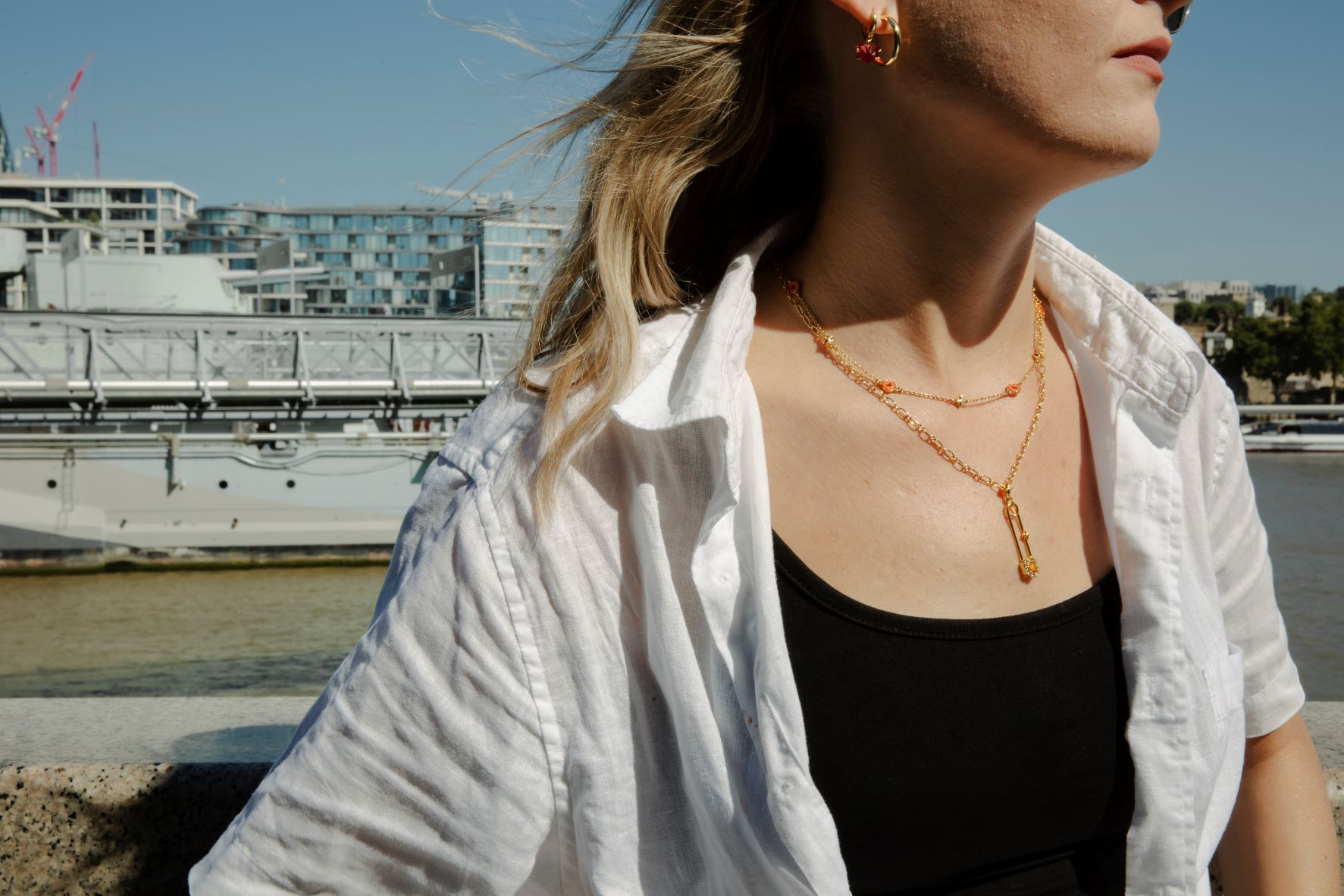 Model wearing all we are jewellery in the sunshine