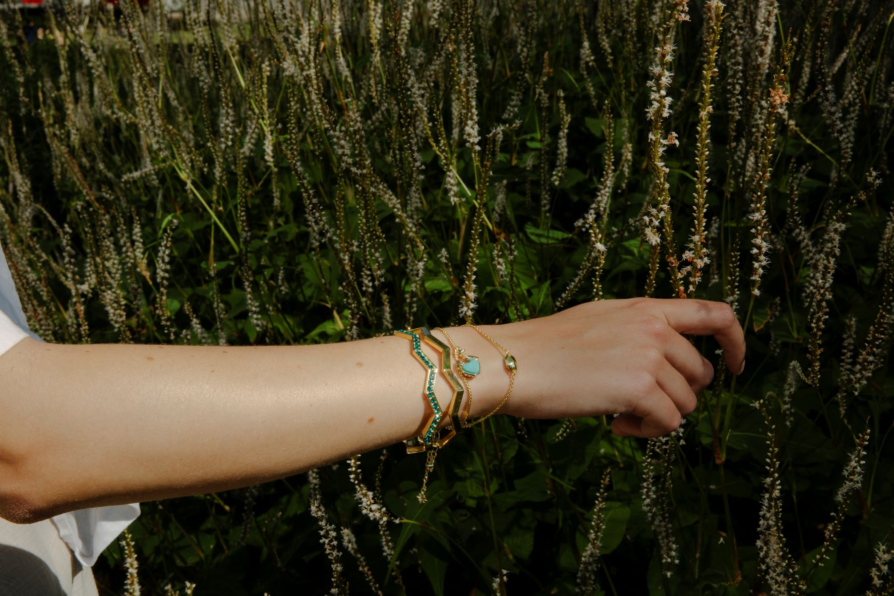 Model wearing all we are bracelets